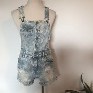 Acid wash overalls with adjustable strap